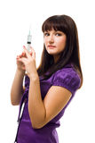 Woman standing with big syringe Stock Images
