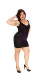 Woman standing in black dress. Royalty Free Stock Photos