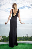 Woman standing in black fashion dress Royalty Free Stock Image