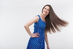 Woman standing in blue dress Royalty Free Stock Photo