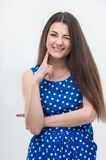 Woman standing in blue dress. Emotional attractive young brunette woman with long hair in blue dress standing in half length isolated on white background Stock Photography