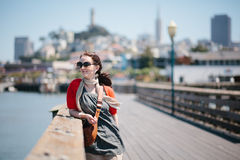 Woman standing at a boardwalk of fishermans wharf, San Francisco, California Stock Photography