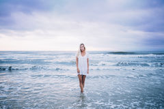 Woman in Standing Body of Water While Wearing White Scoop Neck Top Stock Photo
