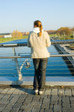 Woman standing on the bridge Royalty Free Stock Images
