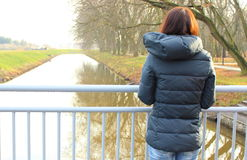 Woman standing on bridge and looking into distance Royalty Free Stock Photos