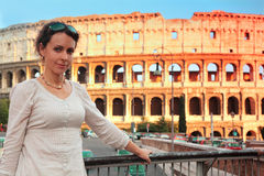Woman standing on bridge near Colosseum Royalty Free Stock Photography