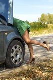 Woman standing by broken car. And looking to engine Stock Photos