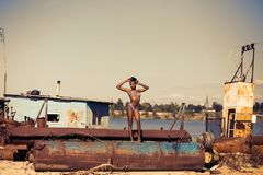Woman Standing on Brown Steel Container Wearing Two-piece Bikini Royalty Free Stock Photo