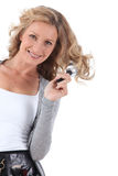 Woman standing brushing hair Stock Photos