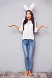 Woman standing in bunny ears Royalty Free Stock Image