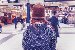 Woman standing in busy train terminal Royalty Free Stock Photos