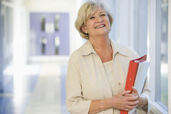 A woman standing in a campus corridor Royalty Free Stock Image