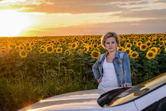 Woman Standing Beside Car in Sunflower Field Royalty Free Stock Photo