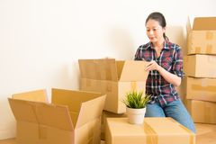Woman standing among cardboard boxes stock images