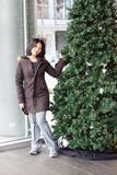 Woman standing by christmas tree at convention center stock images