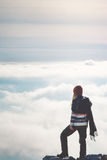 Woman standing on cliff alone thinking Stock Photography