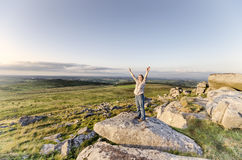 Woman Standing on Cliff Royalty Free Stock Photos