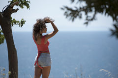 Woman standing at the cliff edge Stock Image
