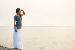 Woman standing on coast Stock Photos