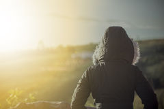 Woman standing in the cold weather. A woman standing in the cold weather Stock Photo