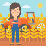 Woman standing with combine on background. Royalty Free Stock Photography