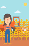 Woman standing with combine on background. Stock Images