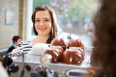 Woman Standing At Counter In Coffeeshop Royalty Free Stock Photos