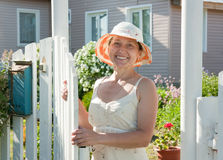 Woman standing at  country house Royalty Free Stock Image