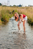 Woman standing in creek summer Royalty Free Stock Image