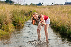 Woman standing in creek summer Royalty Free Stock Photos