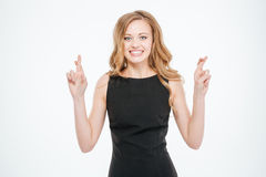 Woman standing with crossed fingers Stock Photography