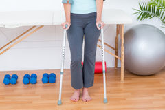Woman standing with crutch Stock Photo