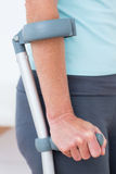 Woman standing with crutch Stock Photos