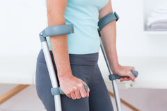 Woman standing with crutch Royalty Free Stock Images