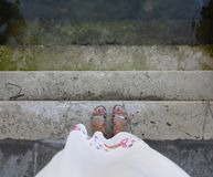 Woman standing on dangerous stone stairs royalty free stock photos
