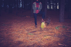 Woman standing in dark forest Royalty Free Stock Photography