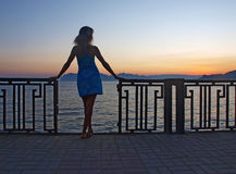 Woman standing at dawn Stock Images
