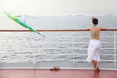 Woman standing on deck of cruise ship Stock Photography