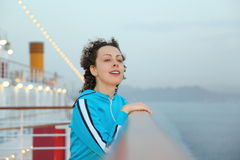 Woman standing on deck of cruised ship Royalty Free Stock Images