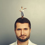 Woman standing on the displeased man Stock Photography