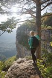 Woman standing on the edge of canyon. Stock Image