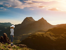 Woman standing on the edge of a cliff Stock Images