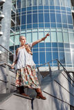 Woman standing on the edge of the roof. Stock Image