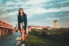 Woman Standing On Edge Of Wall Royalty Free Stock Images