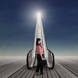 Woman standing on the escalator Stock Image