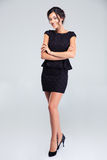Woman standing in fashion dress with arms folded Royalty Free Stock Photo