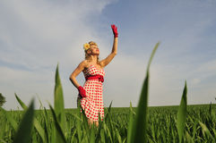 Woman standing in a field Royalty Free Stock Images
