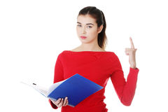 Woman standing with files. Vertical. Woman standing with files and pointing up. Vertical. Isolated on white Royalty Free Stock Photography