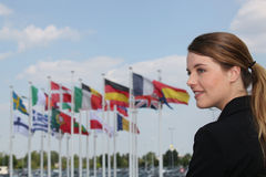 Woman standing by flags Stock Image