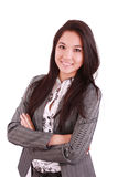 Woman standing with folded hand. Portrait of a happy young business woman standing with folded hand against white background royalty free stock photo